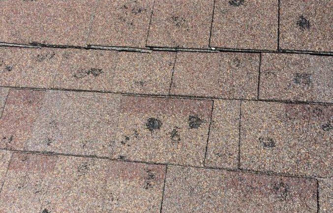 degats de la grele sur un toit